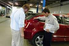 Bodytech Auto Body Collision Repair Services Advisor closely inspecting vehicle for estimate